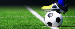 soccer player cleat on ball