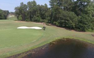 TurfBreeze fan next to golf green and water hazard
