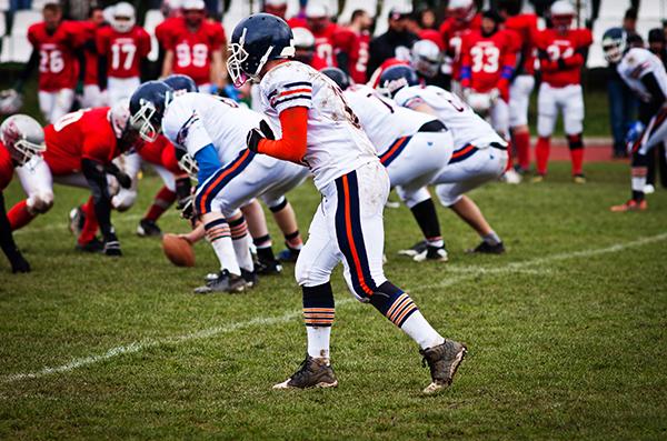 Football teams playing on modern turf